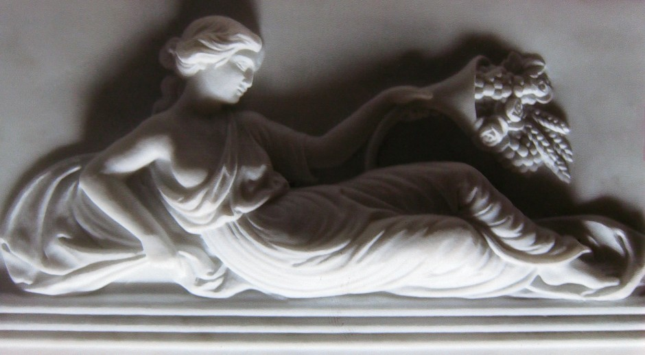 A reverse lit photo to show detail - marble carving reclining lady