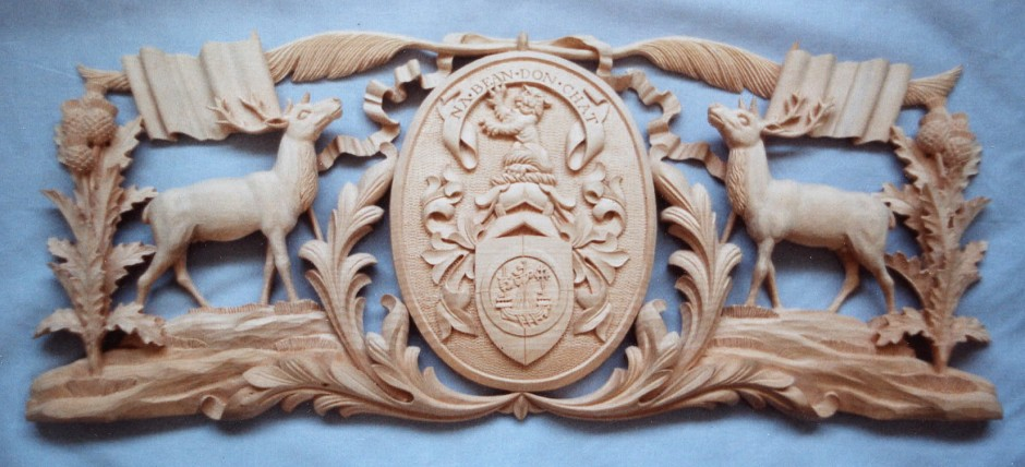 An Overall View Of The Hand Carved Plaque By Jose Sarabia - deer thistle wood carving