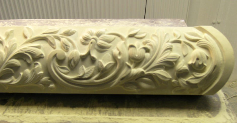 Close up detail of the right hand side of the traditionally stone carved centre piece - traditional stone carving