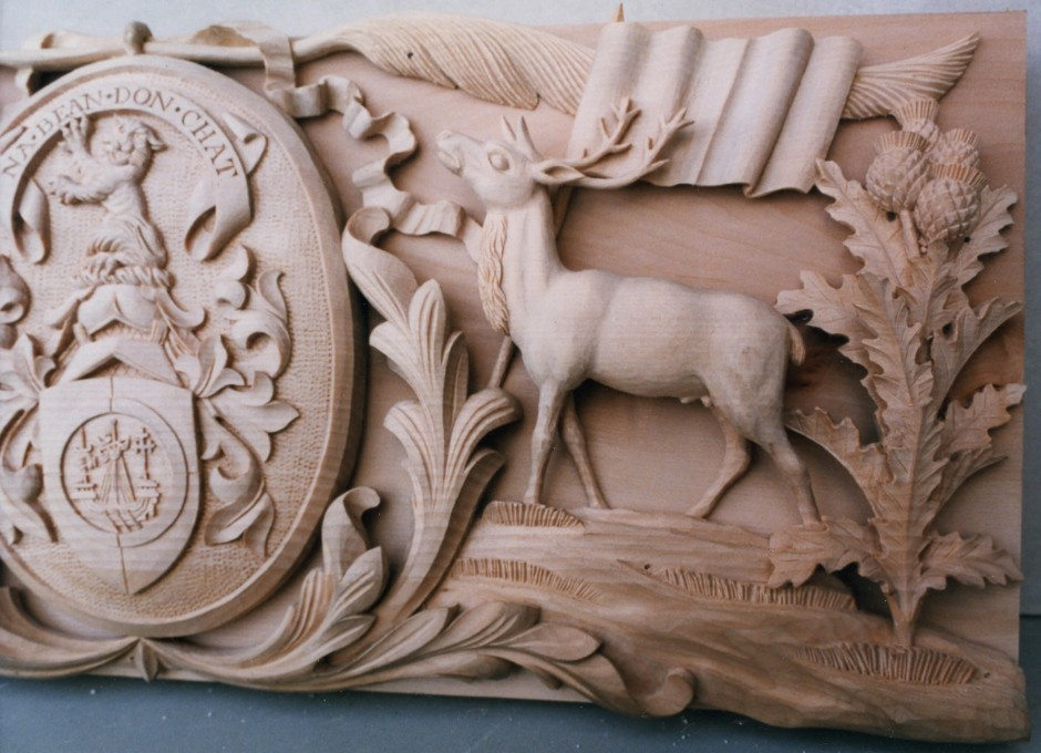 Enlarged view of the right hand side showing carving details - wood carving thistle deer ribbon