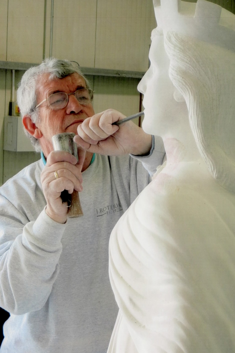 Jose Sarabia at work on the War Memorial Statue - horndean war memorial