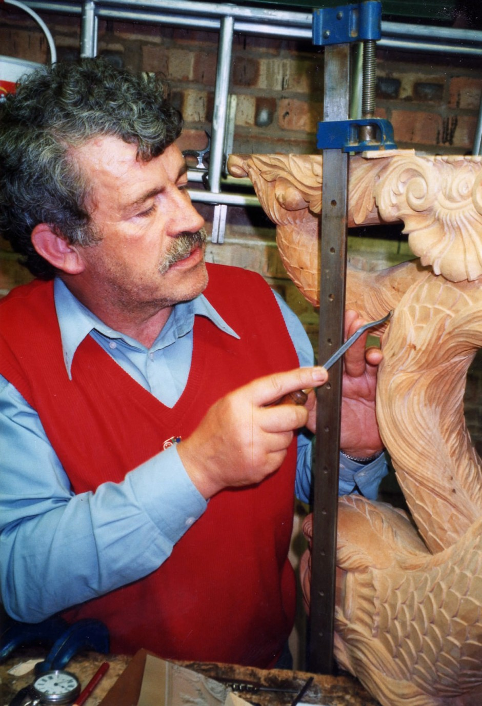 Jose adds final details to the carvings - final carving, light touches