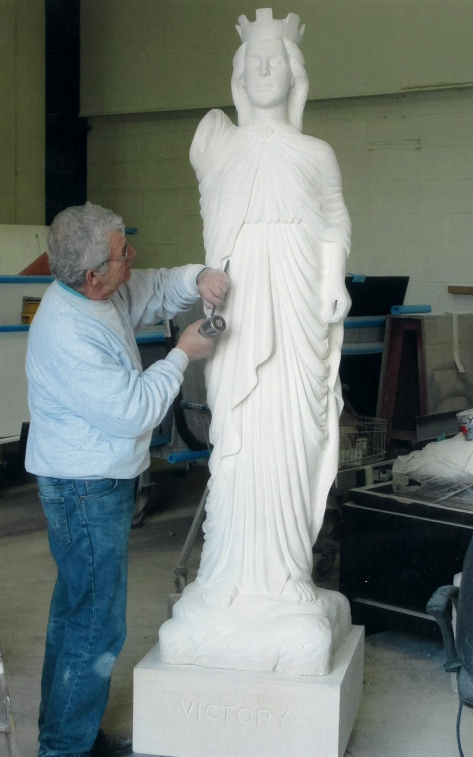 Jose carrying out final detail carving - nike horndean statue carving