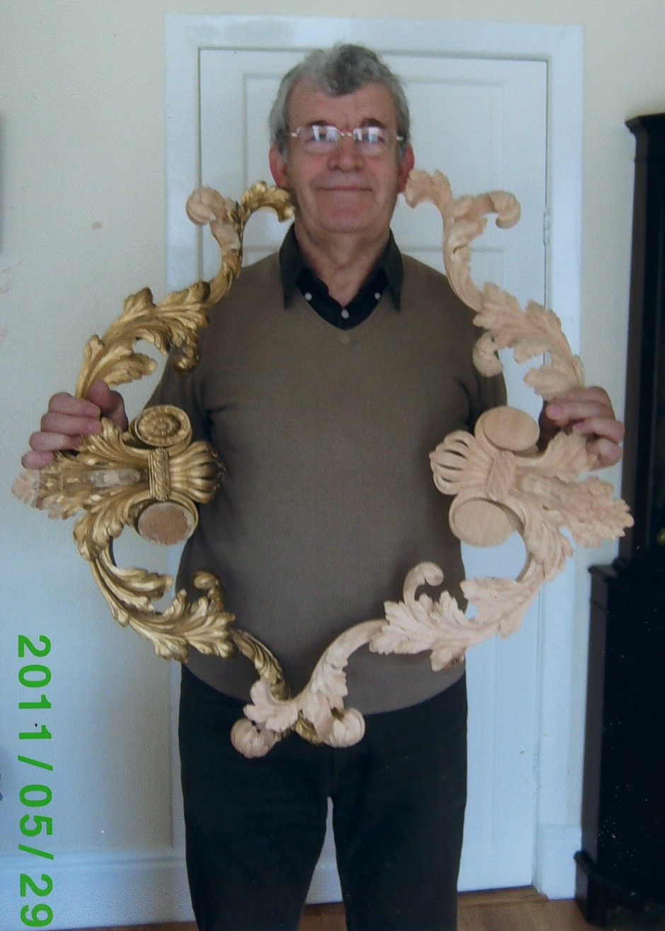 Jose with 2 restored segments of the Chippendale Mirror Frame - chippendale mirror jose sarabia