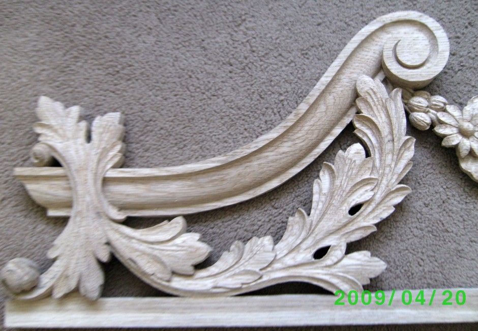 Left hand edge of the traditionally carved door frame top - traditional wood carving