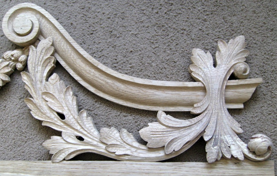 Right hand edge of the traditionally carved door frame top - wooden door frame top