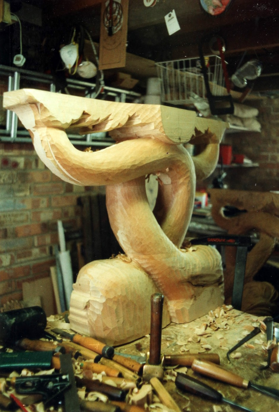 Table leg in the early stages of carving - dolphin table, console table, table legs, hand carved