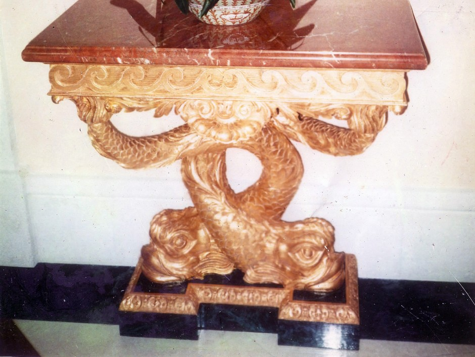 The original console table to be reproduced - console table with dolphin feature legs guilded