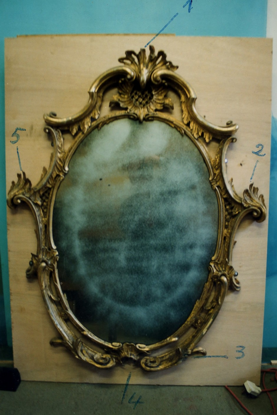 The original mirror prior to restoration - mirror needing restoration